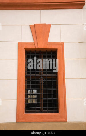 Window covered with a cast iron grill on a building in the Prague Castle district, Prague, Czech Republic - Stock Photo