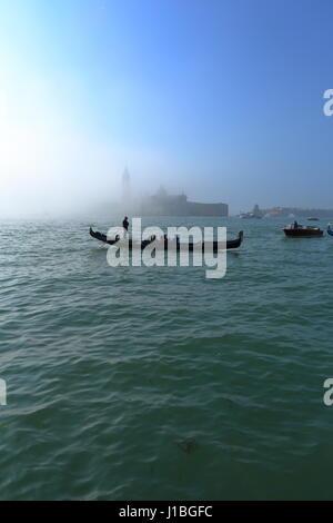 Venice, Italy, seaside next to St. Mark's square. Gondola ride in Venice, famous tourist attraction. - Stock Photo