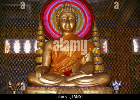 Golden statue of  Buddha (Buddah) in Wat Krom. Sihanoukville, Cambodia - Stock Photo