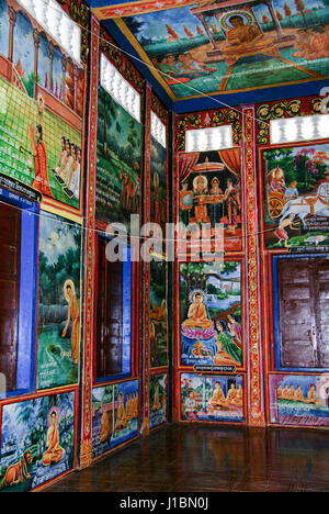 Some of the brightly colored paintings inside Wat Kraom. Sihanoukville, Cambodia - Stock Photo