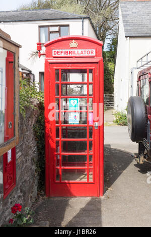 Old red telephone box converted to store a defibrillator - Stock Photo