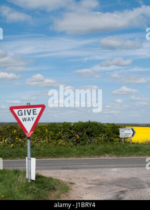 West Tytherley, Hampshire, England - April 18, 2017: Give way traffic sign on T junction of single lane country - Stock Photo