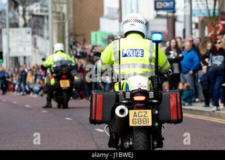 psni police officer traffic police on bmw motorbike during a parade in northern ireland - Stock Photo