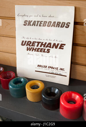 Roller Sports Inc. book of 'Everything you need to know about skateboards' and vintage urethane skateboard wheels - Stock Photo