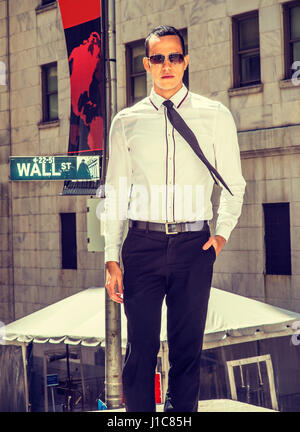 Young American Businessman traveling, working in New York, wearing white shirt, black pants, tie, sunglasses, standing - Stock Photo