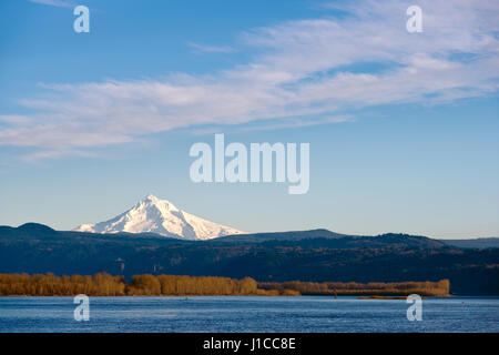 The picturesque landscape with water as the Columbia River, with plants in the form of a strip of trees, with a - Stock Photo