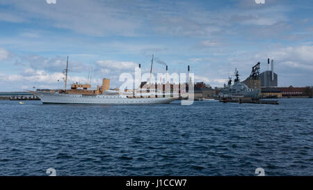 The Royal Yacht Dannebrog moored in copenhagen harbour with the waste to energy plant, Amager Bakke, in the background. - Stock Photo