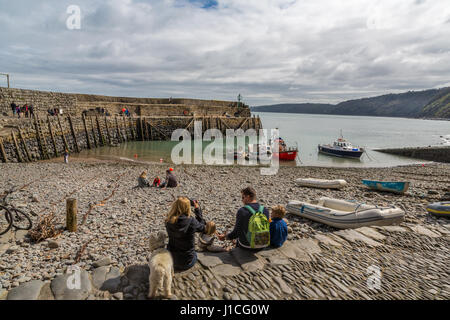 A family enjoy the view from Clovelly Quay Harbour,Hartland Devon Heritage Coast,North Devon,UK,England. A area - Stock Photo