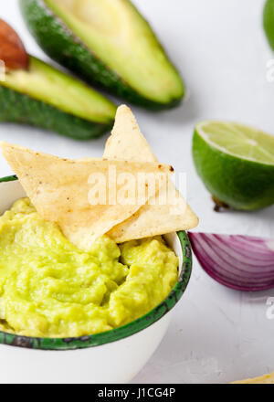 Guacamole with nachos avocado in Mexican molcajete in aged ...