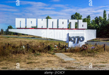 Welcome sign of Pripyat city in Chernobyl Nuclear Power Plant Zone of Alienation exclusion area around the nuclear - Stock Photo