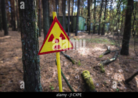 Ionizing radiation warning sign in Pripyat city of Chernobyl Nuclear Power Plant Zone of Alienation around the nuclear - Stock Photo