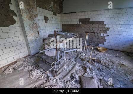 Operating room in Hospital No. 126 of Pripyat ghost city, Chernobyl Nuclear Power Plant Zone of Alienation in Ukraine - Stock Photo