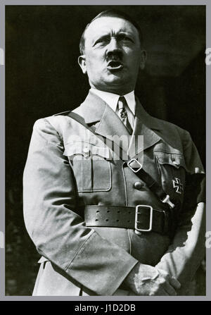 Adolf Hitler in uniform wearing a self awarded Iron Cross medal making a speech to a rally of Hitler Youth at Nuremberg - Stock Photo