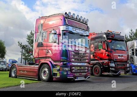 ALAHARMA, FINLAND - AUGUST 12, 2016: Colorful Scania R520 Bruce Lee of Martin Pakos and customized MAN of Markku - Stock Photo