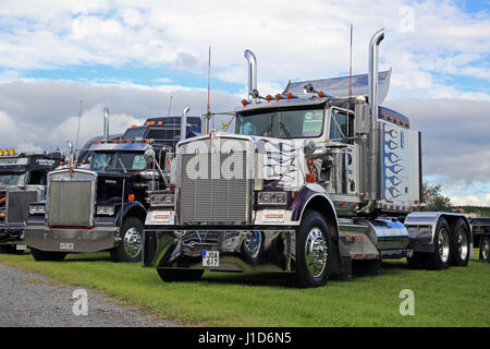 ALAHARMA, FINLAND - AUGUST 12, 2016: Two Classic Kenworth W900 semi trucks on display on the annual trucking event - Stock Photo