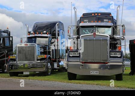 ALAHARMA, FINLAND - AUGUST 12, 2016: Classic Kenworth W900 on display beside Peterbilt semi truck on the annual - Stock Photo