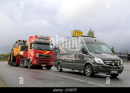 FORSSA, FINLAND - SEPTEMBER 4, 2016: Mercedes-Benz Sprinter pilot vehicle and Volvo FH semi truck transporting wheel - Stock Photo