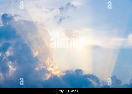 Beams of sun light. Rays of evening sunlight shining through clouds, England, UK