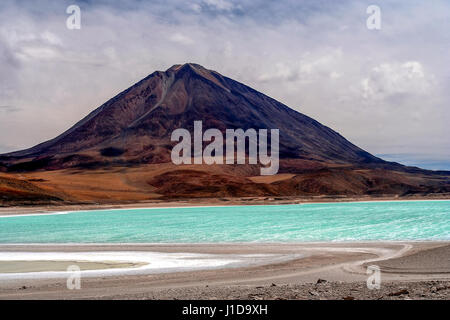 Green lagoon called Laguna Verde in Altiplano mountains, southern Bolivia - Stock Photo