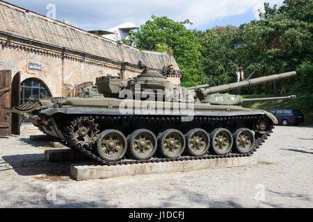 POZNAN, POLAND - AUG 20, 2014: Preserved T-72 tank on display in front of the Poznan Army Museum. - Stock Photo