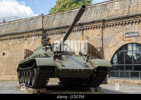POZNAN, POLAND - AUG 20, 2014: Preserved T-55 tank on display in front of the Poznan Army Museum. - Stock Photo