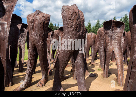 POZNAN, POLAND - AUG 20, 2014: Iron 2 meter tall headless figures marching aimlessly across the Citadel Park in - Stock Photo
