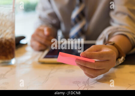 IOT Internet of things concept, Businessman holding pink note and using tablet for shopping and payment online in - Stock Photo
