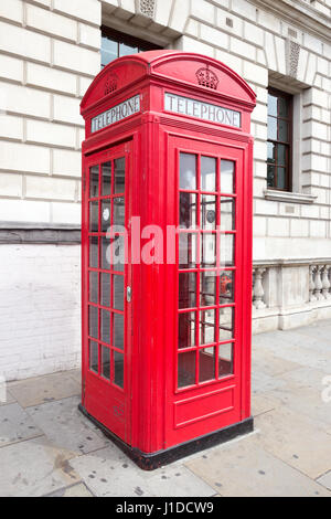 Traditional red telephone box in London. - Stock Photo