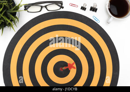 Isolated On White Background; Dart Target Arrow Hitting On Bullseye In  Dartboard Over Office Desk Table Background With Eye Glasses