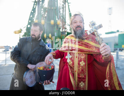 A russian orthodox priest blessing the easter gifts stock photo a russian orthodox priest hands out easter eggs to the media during the traditional blessing of negle Images
