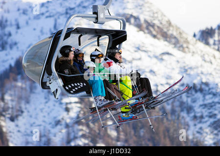 FLACHAU, AUSTRIA - DEC 27, 2012: Skiiers on a ski lift to a piste in the Austrial Alps. These pistes are part of - Stock Photo
