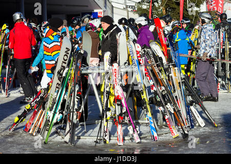 FLACHAU, AUSTRIA - DEC 29, 2012: People at the ski pistes in the ski resort town of Flachau in the Austrian Alps. - Stock Photo