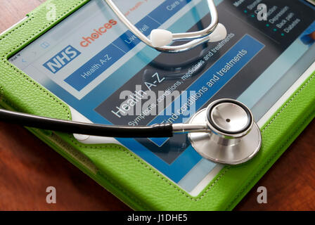 nhs website on ipad tablet computer - Stock Photo