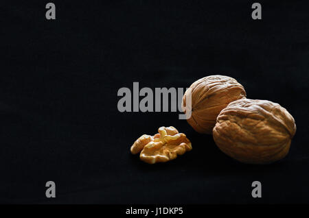 Walnuts in black background with copy space - Stock Photo