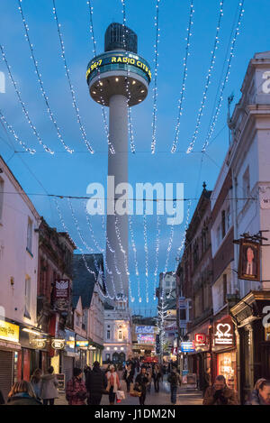 The St, John's beacon twoer in Williamson Square Liverpool floodlit at night. Christam decorations - Stock Photo