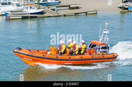 RNLI crew speeding up a river estuary in a lifeboat rib on the River Arun, Littlehampton, West Sussex, England, - Stock Photo