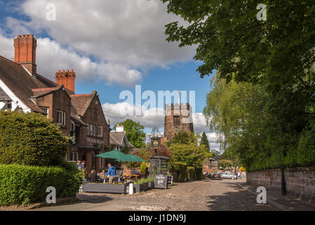 St Wilfrid's C of E Church in Grappenhall at the end of the cobbled street in Grappenhall Warrington with pub close - Stock Photo