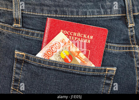 Moscow, Russia - November 27, 2016: Russian passport, money and credit card MasterCard sticking out of the back - Stock Photo