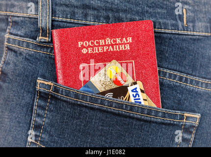 Moscow, Russia - November 27, 2016: Russian passport, credit cards MasterCard and Visa in back jeans pocket. Travel - Stock Photo