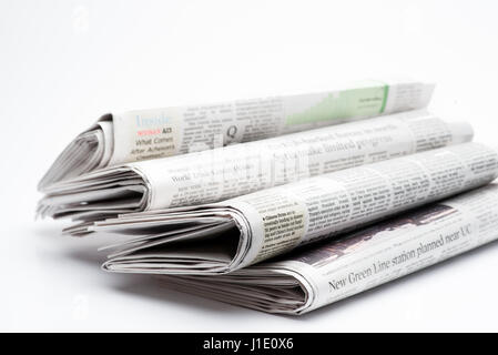 Chicago- Feb 12,2017:  stack of folded newspapers The Wall Street Journal and Chicago Tribune on white background(for - Stock Photo