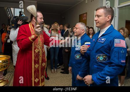 Baikonur, Kazakhstan. 20th Apr, 2017. Russian cosmonaut Fyodor Yurchikhin, center, receives the traditional blessing - Stock Photo