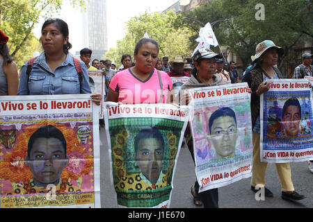 Mexico City, Mexico . 20th Apr, 2017. Parents and relatives of the 43 missing students march to demand an efficient - Stock Photo