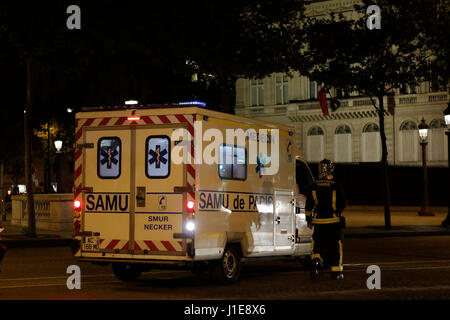 Paris, France. 20th April 2017. An ambulance is parked at the Champs-Elysees. The Champs-Elysées avenue in Paris - Stock Photo