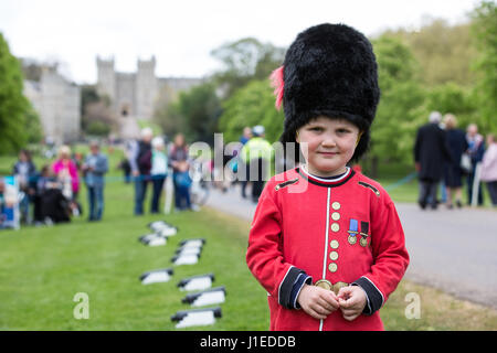 Windsor, UK. 21st April, 2017. Zachary Hamill, aged 4, stands in front of Windsor Castle after firing the 15th cannon - Stock Photo