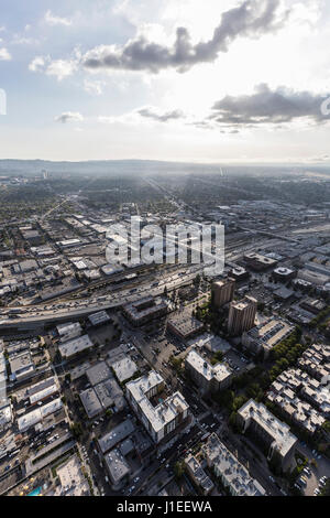 Aerial view of downtown Burbank with the San Fernando Valley area of Los Angeles California in background. - Stock Photo