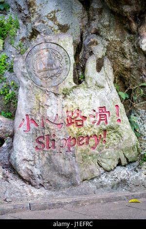 Guizhou Province, China.  Yellow Fruit Tree (Huangguoshu) Waterfall Scenic Area.  Warning for Tourists: Slippery! - Stock Photo
