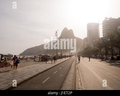 RIO DE JANEIRO, BRAZIL - OCTOBER 24, 2016:  People enjoy the Ipanema Beach at Sunset in Rio de Janeiro - Stock Photo