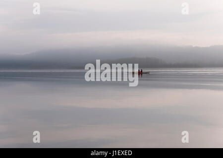 Canoeing on the Columbia river in fog weather. The silence of nature soothes and relaxes two people along Columbia - Stock Photo
