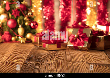 Christmas theme. Set of Christmas gifts on wooden table - Stock Photo