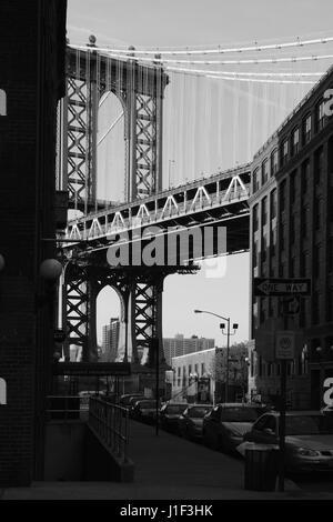Old backstreet in DUMBO Brooklyn, New York at sunset with the Manhattan Bridge down Washington Street. Monochrome, - Stock Photo